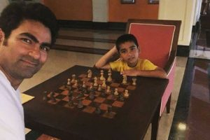 Mohammad Kaif playing chess with his son