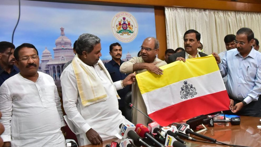 Ahead of polls Siddaramaiah unveils proposed Karnataka flag