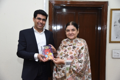 Debut author presents first copy of his Sci-Fi Book to Maneka Gandhi