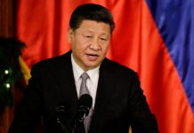 China's President Xi Jinping speaks during a joint news statement at the Malacanang presidential palace in Manila