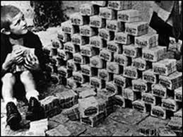German Child Sitting Next to Pile of Cash Amidst Hyperinflation