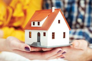 Representative image of a couple buying a house using a home loan
