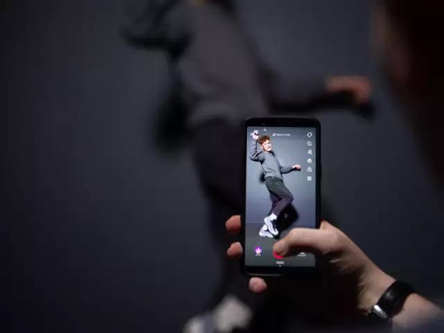 A man dancing video being shot in TikTok || Source: KrAsia