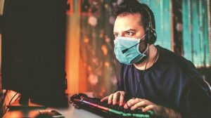 Online Gamer playing with a Mask amid covid-19