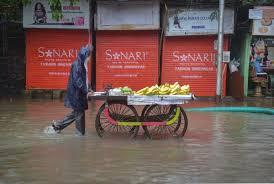 local vendor navigating through water logged roads