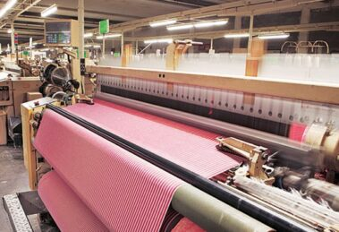 The textile industry is primarily concerned with the design, production and distribution of yarn, cloth and clothing.